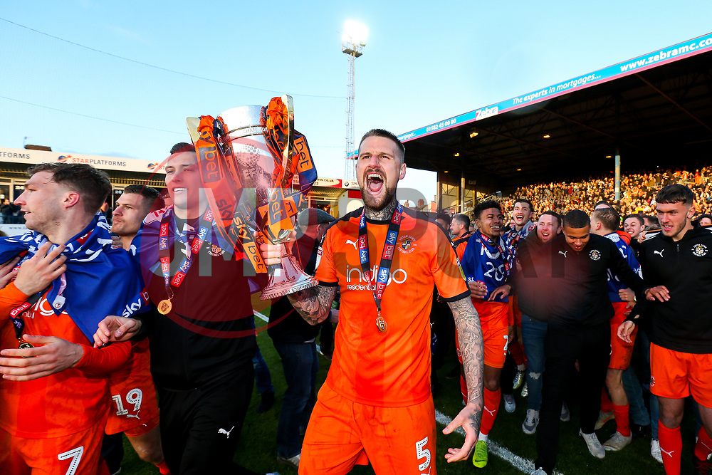 Sonny Bradley screams out with the trophy as Luton Town celebrate winning the league and securing automatic promotion from Sky Bet League 1 to the Sky Bet Championship - Rogan/JMP - 04/05/2019 - Kenilworth Road - Luton, England - Luton Town v Oxford United - Sky Bet League One.