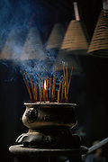Incense burns in Macau's Temple of Kun Iam Tong (goddess of mercy)