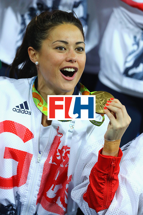 RIO DE JANEIRO, BRAZIL - AUGUST 19:  Samantha Quek #13 of Great Britain reacts with her gold medal after defeating Netherlands in the Women's Gold Medal Match on Day 14 of the Rio 2016 Olympic Games at the Olympic Hockey Centre on August 19, 2016 in Rio de Janeiro, Brazil.  (Photo by Tom Pennington/Getty Images)