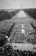 Crowds on The Mall, starting at the Lincoln Memorial, going around the Reflecting Pool, and continuing to the Washington Monument,. USA. 28 August 1963. Photographer:  Warren K  Leffler.