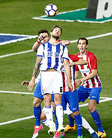 Atletico de Madrid's Saul Niguez (l) and Diego Godin (r) and Real Sociedad's Inigo Martinez during La Liga match. April 4,2017. (ALTERPHOTOS/Acero)