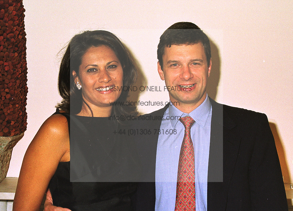 MR & MRS LEONARDO GOULANDRIS members of the leading Greek shipping family, at a party in London on 9th July 1998.MIY 10