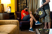 Johny Hendricks checks into his hotel prior to UFC 171 and goes over his diet schedule with coach Mike Dolce at his hotel room in Dallas, Texas on March 11, 2014.