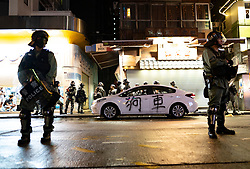 Hong Kong, China. 13th October 2019. Woman suspected of being pro-Beijing is assaulted by pro-democracy protestors in Mongkok district in Kowloon on Sunday evening. This incident was one of several throughout Hong Kong on Sunday which saw acts of vandalism carried out by a minority in the pro-democracy movement. Pic. Unmarked police car is vandalised. Chinese characters for dog car are sprayed on car. Iain Masterton/Alamy Live News.