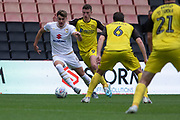 Regan Poole (5) is fouled by Nathan Broadhead (#9 on loan from Everton) during the EFL Sky Bet League 1 match between Milton Keynes Dons and Burton Albion at stadium:mk, Milton Keynes, England on 5 October 2019.