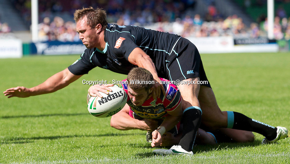 PICTURE BY MARK GREEN/SWPIX.COM...Rugby League - Super League - London Broncos v Leeds Rhinos, The Stoop, Twickenham, England - 30/06/12... Leeds Rhinos Zak Hardaker scores despite pressure from London Broncos Scott Wheeldon