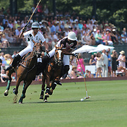 Santino Magrini, (left), White Birch and  Matias Magrini, K.I.G challenge during the White Birch Vs K.I.G Polo match in the Butler Handicap Tournament match at the Greenwich Polo Club. White Birch won the game 11-8. Greenwich Polo Club,  Greenwich, Connecticut, USA. 12th July 2015. Photo Tim Clayton