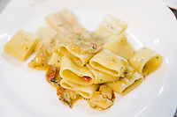 NAPLES, ITALY - 4 JANUARY 2019: Sea Genovese Paccheri are seen here at Janarius, a restaurant in Naples, Italy, on January 4th 2019.<br /> <br /> Janarius is a typical Neapolitan gourmet restaurant and shop founded by Francesco Andoli in September 2018 in via Duomo, in front of the Naples's Duomo and treasure of Saint Janarius.