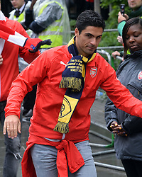 © Licensed to London News Pictures. 31/05/2015. <br /> LONDON, UK. The Arsenal FC first team and manager Arsene Wenger parade the FA Cup trophy through the streets of North London in an open top bus to celebrate winning the FA Cup yesterday. Mikel Arteta partake in the victory parade.  London, Sunday 31 May 2015. Photo credit : Hannah McKay/LNP