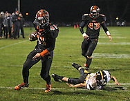 Springville's Drake Coonrod (41) pulls away from Midland's Ben Carstensen (5) and runs into the end zone for a touchdown during their game at Allison Field in Springville on Friday October 19, 2012. Midland defeated Springville 30-29.
