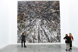 "© Licensed to London News Pictures. 14/11/2019. LONDON, UK. Visitors view ""Ramanujan Summation"" 1/12, 2018-2019, by Anselm Kiefer at the preview of a new exhibition called ""Superstrings, Runes, The Norns, Gordian Knot"" by Anselm Kiefer.  The works include large scale paintings and installations that draw on the scientific concept of string theory and are on display at the White Cube Gallery in Bermondsey 15 November to 26 January 2020.  Photo credit: Stephen Chung/LNP"