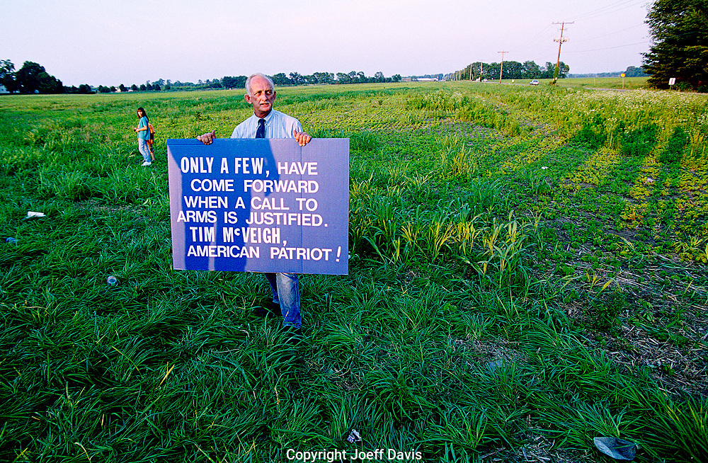 A man holds a sign, June 10, 2001 in a cornfield across from the U.S. Federal Penitentiary in Terre Haute, Indiana where Timothy McVeigh was to be executed the following day.<br /> <br /> His sign reads &quot;Only a few, have come forward when a call to arms is justified. Tim McVeigh, American Patriot!&quot;<br /> <br /> The bombing of the Murrah Building in Oklahoma City which McVeigh was convicted of killed 168 people.