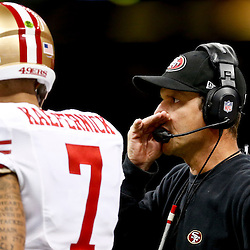 Nov 17, 2013; New Orleans, LA, USA; San Francisco 49ers head coach Jim Harbaugh talks with quarterback Colin Kaepernick (7) during the first quarter of a game against the New Orleans Saints at Mercedes-Benz Superdome. Mandatory Credit: Derick E. Hingle-USA TODAY Sports