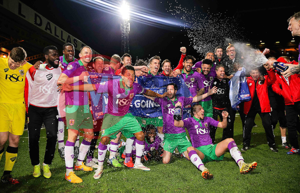 Bristol City players celebrate achieving promotion  - Photo mandatory by-line: Matt McNulty/JMP - Mobile: 07966 386802 - 14/04/2015 - SPORT - Football - Bradford - Valley Parade - Bradford City v Bristol City - Sky Bet League One