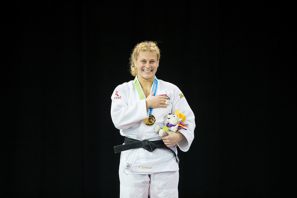 Kayla Harrison of the United States smiles during the national anthem after receiving her gold medal in the women's judo -78kg class at the 2015 Pan American Games in Toronto, Canada, July 14,  2015.  AFP PHOTO/GEOFF ROBINS