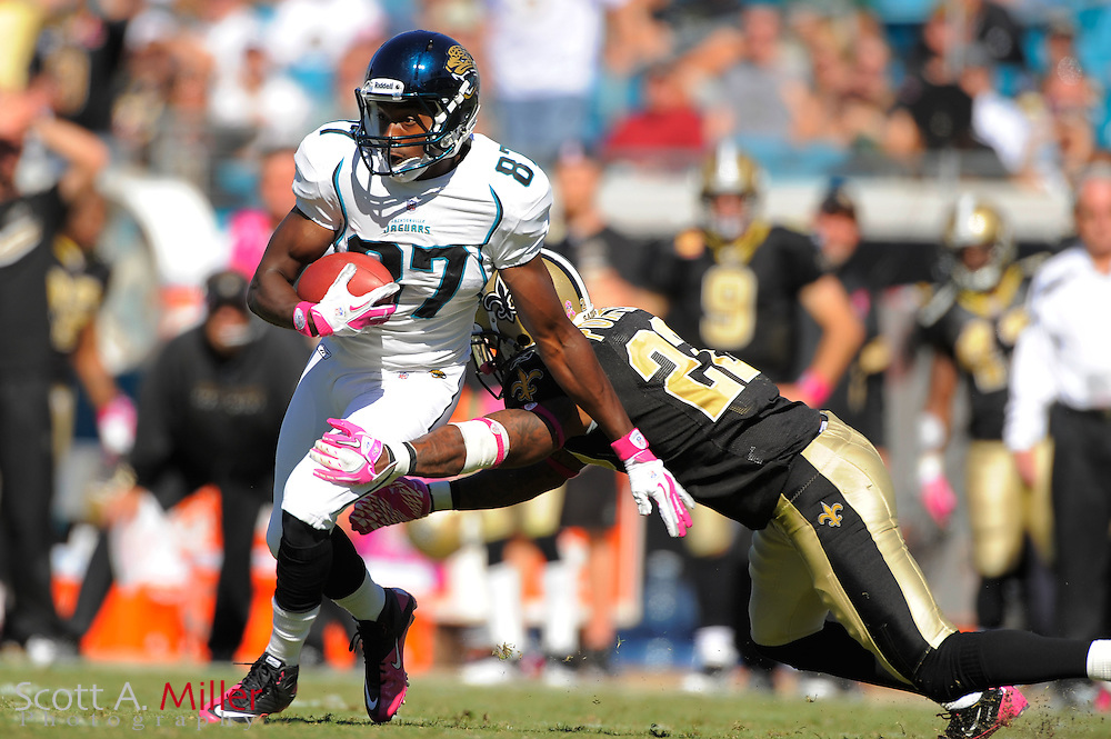 Jacksonville Jaguars wide receiver Jarett Dillard (87) is tackled by New Orleans Saints cornerback Tracy Porter (22) during their game at EverBank Field on Oct. 2, 2011 in Jacksonville, Fla...©2011 Scott A. Miller