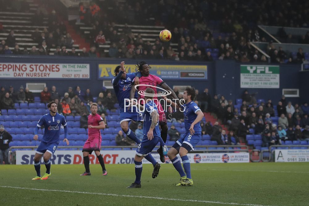 Oldham Athletic defender Charles Dunne (31) challenges Southend United striker Nile Ranger (50) in the air during the EFL Sky Bet League 1 match between Oldham Athletic and Southend United at Boundary Park, Oldham, England on 17 December 2016. Photo by Simon Brady.