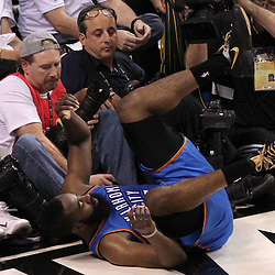 Jun 19, 2012; Miami, FL, USA; Oklahoma City Thunder guard James Harden (13) falls in front of the photographers during the second quarter in game four in the 2012 NBA Finals against the Miami Heat at the American Airlines Arena. Mandatory Credit: Derick E. Hingle-US PRESSWIRE