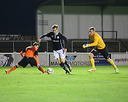 Dundee's Craig Wighton goes round Dundee United's Aiden Connolly and keeper Mark McCallum to score - Dundee v Dundee United, SPFL Development League at Gayfield, Arbroath<br />