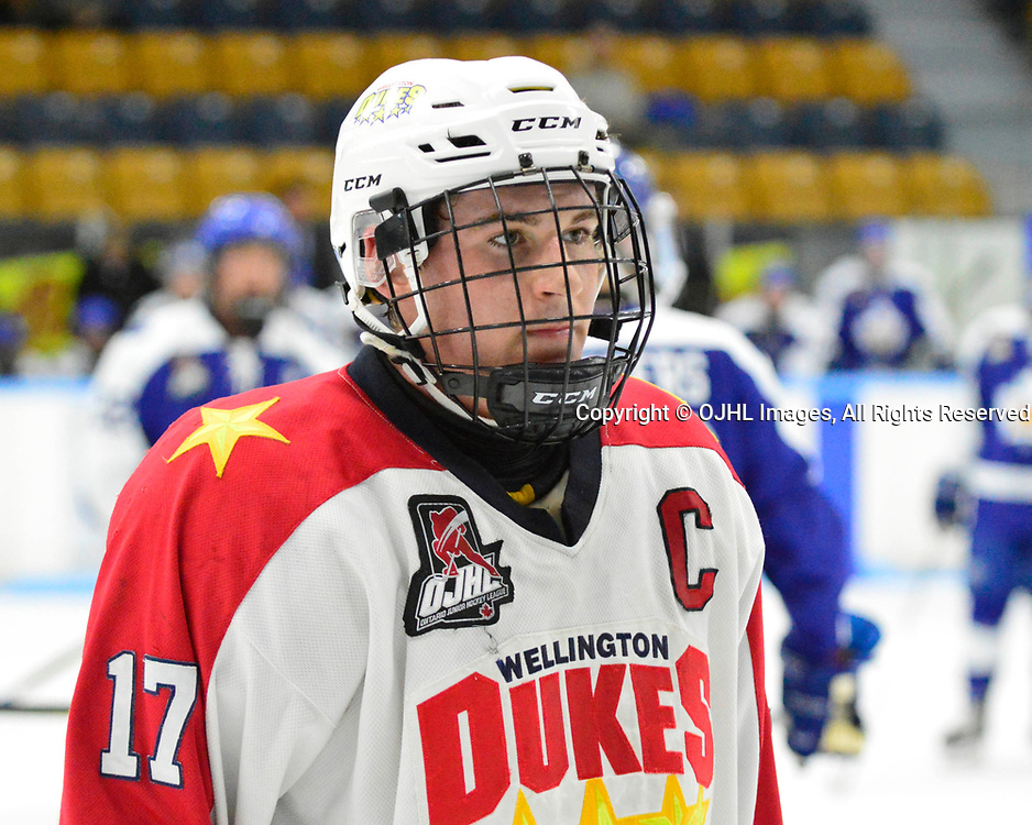 MARKHAM, ON  - SEP 16,  2017: Ontario Junior Hockey League game between the Markham Royals and the Wellington Dukes, Colin Doyle #17 of the Wellington Dukes is escorted to the penalty box.<br /> (Photo by Abhinav Nirula / OJHL Images)