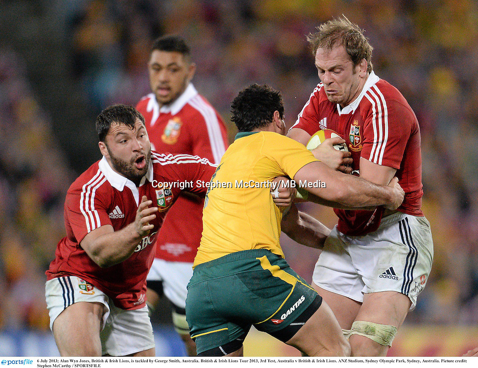 6 July 2013; Alun Wyn Jones, British & Irish Lions, is tackled by George Smith, Australia. British & Irish Lions Tour 2013, 3rd Test, Australia v British & Irish Lions. ANZ Stadium, Sydney Olympic Park, Sydney, Australia. Picture credit: Stephen McCarthy / SPORTSFILE
