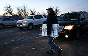 A supporter leaves Republican presidential candidate, Sen. Ted Cruz's meet and greet at Theo's Pizza and Restaurant in Manchester, N.H. Thursday, Jan. 21, 2016.  CREDIT: Cheryl Senter for The New York Times Ted Cruz
