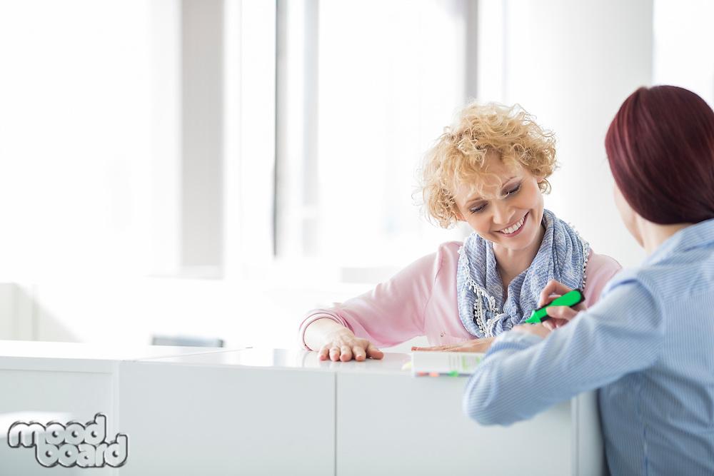 Businesswomen discussing in creative office