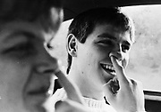 Teenagers joking around in car, Keele, UK, 1983