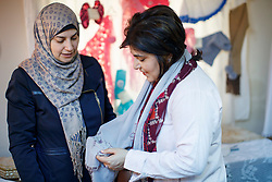 © Licensed to London News Pictures. 28/05/2017. Hatay, Turkey. Former Minister of State for Faith and Communities, BARONESS WARSI is given a scarf during to a Syrian women association which supports Syrian widows and orphans on the Turkish-Syrian border in Hatay, Turkey on the first day of Ramadan. Photo credit: Tolga Akmen/LNP