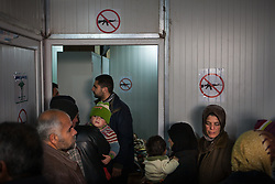Residents from the displaced Syrian camp of Atmah queue up inside a small clinic run by pharmaceutics, nurses and doctors volunteers. Situated along the Turkish border Atmah's refugee camp is considered the biggest refugee camp inside Syria's territory with an estimated number of 13,000 refugees and growing by the day. Most of them from from Idlib and Hama province but also some residents come from Homs province, Syria, February 8, 2013. Photo by Daniel Leal-Olivas / i-Images.