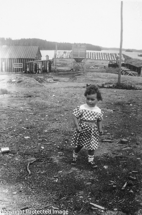 Bernice looking for the alien landing site. I think that's the main camp and mill in the background. Wish I knew the name of the lake. Owakonze circa 1949