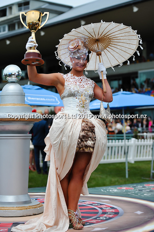 Miki Wilson with the NZ Cup during the New Zealand Cup Meeting at Riccarton Park, Christchurch. 14th November 2015. Copyright Photo: John Davidson / www.photosport.nz