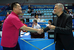 Japan coach Manabe Masayoshi and Belgium head coach Gert Vande Broek shake their hands