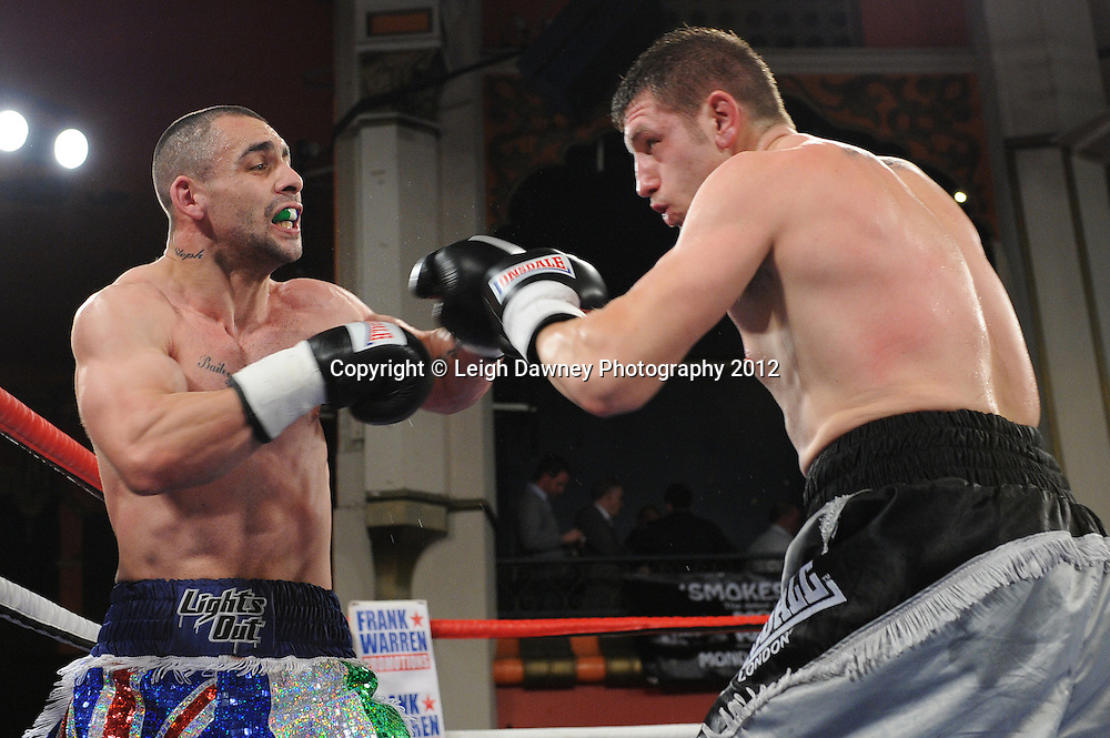 Steve Spence (grey/black shorts) defeats Lyndon Newman in a 4x3 min Middleweight contest at Olympia, Liverpool on the 21st January 2012. Vaughan Boxing Promotions. © Leigh Dawney Photography 2012.