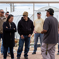 The Naval Mobile Construction Battalion 18 gets a tour of the Community Pantry's garden before they volunteer and fill food boxes on April 22, 2019 in Gallup.