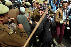 SRINAGAR, KASHMIR,INDIA, MARCH 20, 2004:Bilkees Manzoor, an eighteen-year-old girl whose father was taken away by Indian security forces in January 2002 and never returned, argues with Jammu and Kashmir police to allow them to march to the United Nations compound in the name of the the Association of Parents of Disappeared Persons (APDP)  in Srinagar, the summer capital of Indian held Jammu and Kashmir state in India, March 20, 2004. At least a dozen people were wounded when police used batons to disperse hundreds of protestors. APDP says more than six thousand people have gone missing since the bloody revolt erupted in Kashmir.