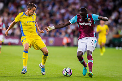 Marko Alvir of NK Domzale and Cheikhou Kouyate of West Ham during 2nd Leg football match between West Ham United FC and NK Domzale in 3rd Qualifying Round of UEFA Europa league 2016/17 Qualifications, on August 4, 2016 in London, England.  Photo by Ziga Zupan / Sportida