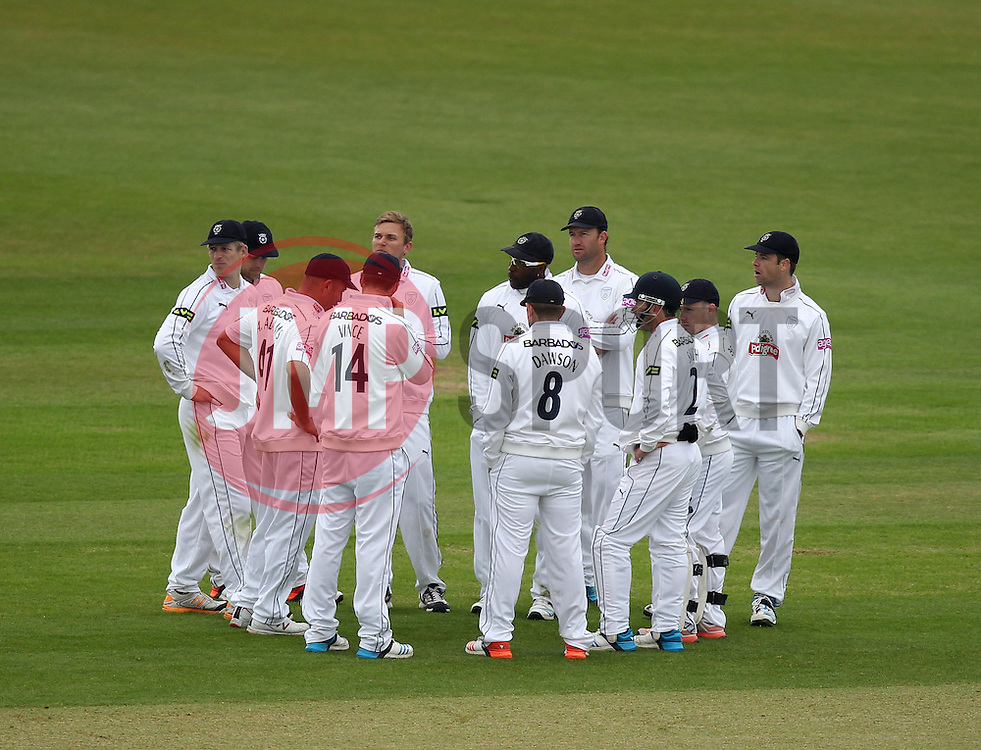 Hampshire players gather after the wicket of Nottinghamshire's Billy Taylor - Photo mandatory by-line: Robbie Stephenson/JMP - Mobile: 07966 386802 - 26/04/2015 - SPORT - Cricket - Southampton - The Ageas Bowl - Hampshire v Nottinghamshire - County Championship Division One