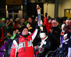 10.01.2016, Schladming, AUT, Special Olympics Pre-Games in Graz-Schladming-Ramsau, Eröffnungsfeier im WM-Park Planai, im Bild Athlet Alexander Radin (AUT) mit der olympischen Flamme // athlete Alexander Radin of Austria with the olympic flame during the opening ceremony of the Special Olympics Pre-Games in Schladming, Austria on 2016/01/10. EXPA Pictures © 2016, PhotoCredit: EXPA / Martin Huber