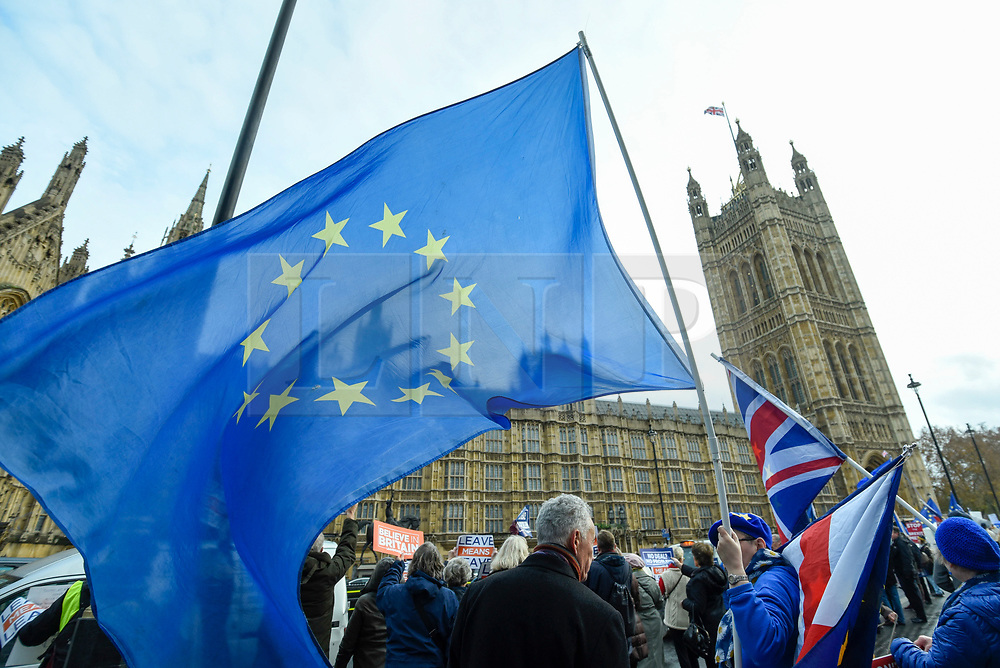 © Licensed to London News Pictures. 05/12/2018. LONDON, UK.  Anti-Brexit supporters demonstrate outside the Houses of Parliament as MPs debate Theresa May's Brexit deal with the European Union ahead of the meaningful vote of December 11.  Photo credit: Stephen Chung/LNP