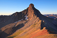 Sunrise strikes the northern flank of Wetterhorn Peak 14,015ft, San Juan mountains.