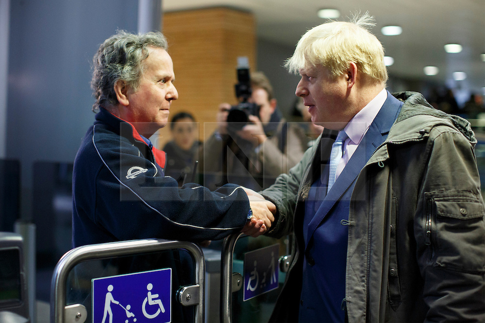 © licensed to London News Pictures. London, UK 05/02/2014. Mayor of Boris Johnson talking to TFL staff before leaving London Bridge Underground Station on his way to City Hall during the 48 hour tube strike called by RMT Union on Wednesday, 5 February 2014. Photo credit: Tolga Akmen/LNP