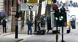 CAPTION CORRECTION TODAY PICTURES ORIGINALLY DATED INCORRECTLY© under license to London News Pictures. LONDON, UK  16/05/2011. A bomb disposal robot has been used after police have closed of Northumberland Avenue and surrounding areas in Central London after a disturbed manhole cover was discovered in the road. Photo credit should read Ben Cawthra/LNP. Please see special instructions.