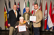 Wildwood native John Reasor (right), an animal science major, receives an Oklahoma State University Mable and Houston Ward, Sr. Memorial Endowed Scholarship from Houston Ward (left), Dixie Ward Greer, and Dr. Jewell Ward at the university's recent College of Agricultural Sciences and Natural Resources Scholarships and Awards Banquet. The scholarship is part of more than $1.4 million in scholarships and awards presented to CASNR students for the 2016-2017 academic year. (Photo by Todd Johnson)