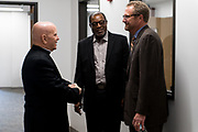 DENVER, CO - AUGUST 24: Denver Archbishop Samuel J. Aquila (L) speaks with Catholic Charities President and CEO Larry Smith (R) and another attendee during the grand opening event for the Samaritan House Women's Shelter on August 24, 2017, in Denver, Colorado. (Photo by Anya Semenoff/for Catholic Charities)
