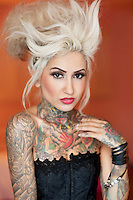 Portrait of stylish tattooed woman