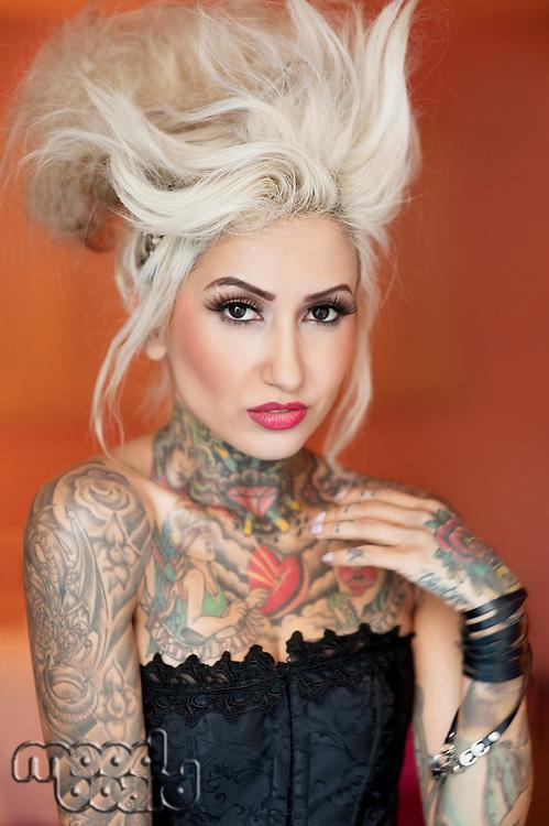 Portrait of stylish tattooed woman