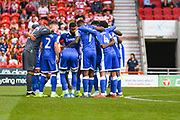 Gillingham players huddle during the EFL Sky Bet League 1 match between Doncaster Rovers and Gillingham at the Keepmoat Stadium, Doncaster, England on 3 August 2019.