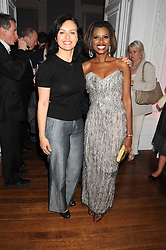Left to right, CAROLINE FLINT MP and JUNE SARPONG at the launch of Politics and The City - a new web site for women fusing politics with gossip, entertainment, news and fashion, held at the ICA, 12 Carlton House Terrace, London on 8th July 2008.<br />