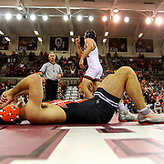 Oklahoma State's Chandler Rogers reacts to his loss while lying on the ground as Oklahoma's Clark Glass celebrates by pointing up after his win during the Bedlam wrestling dual at McCasland Field House in Norman, Oklahoma, Friday, December 2, 2016. Kurt Steiss/O'Colly